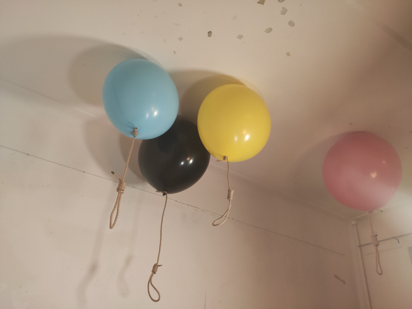 These balloons represent the Khachaturyan sisters and their father.  Loretta Marie Perera / MT