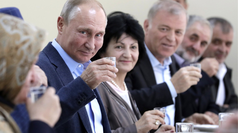 Putin Drinks Vodka to Russian Soldiers in North Caucasus