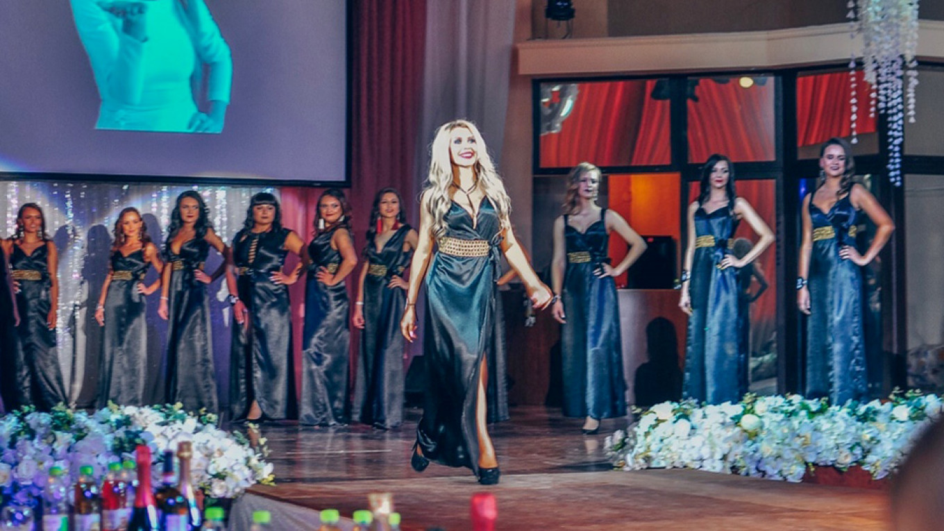Russian Priest Banished Over Wife's Miss Sensuality Win