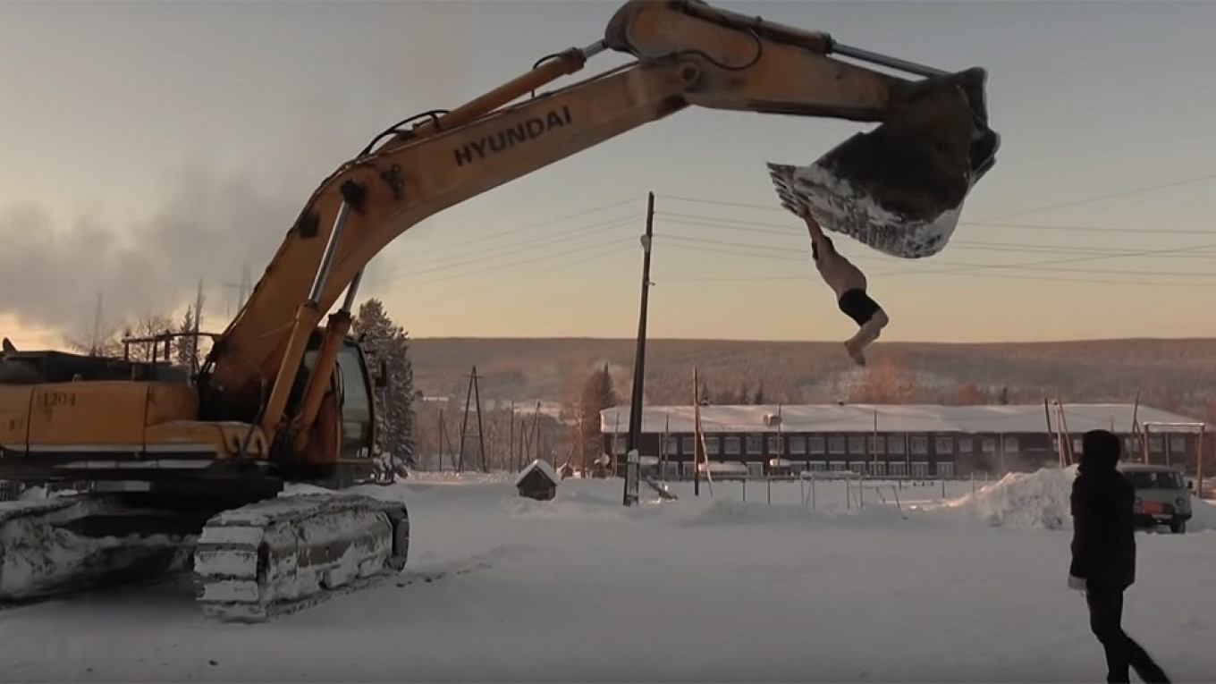 Siberian Man in Underwear Rides Excavator Bucket in -40 C, Douses
